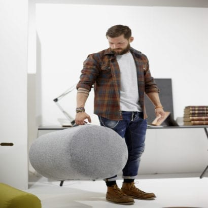 man carrying beanbag