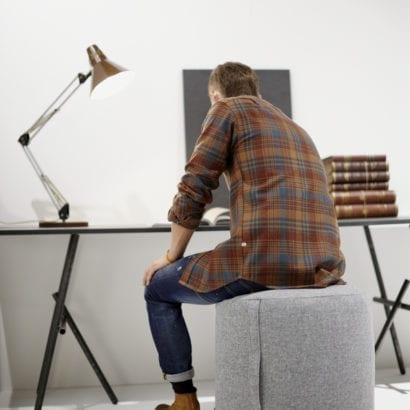 man sitting on beanbag