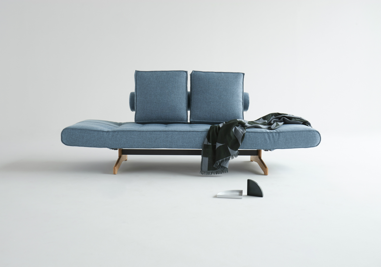 a blue danish sofa bed on a white background