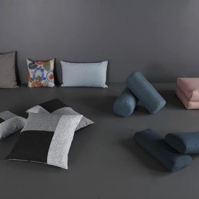 a pile of danish designed cushions