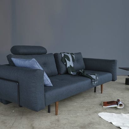 dark blue sofa with cushion and throw