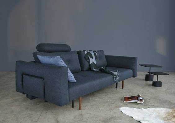 dark blue sofa with cushion and throw