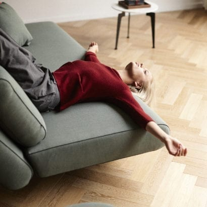 girl lying on sofa bed