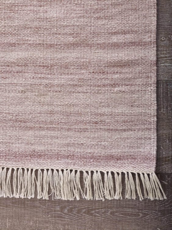pink tassel rug