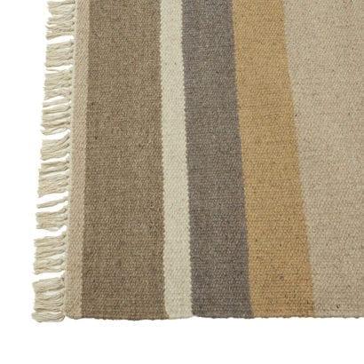 multicoloured tassel rug
