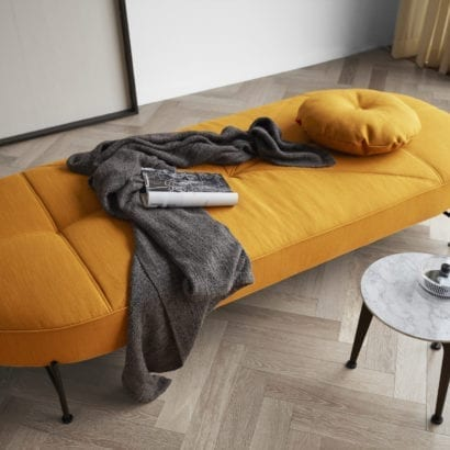 yellow daybed with grey blanket