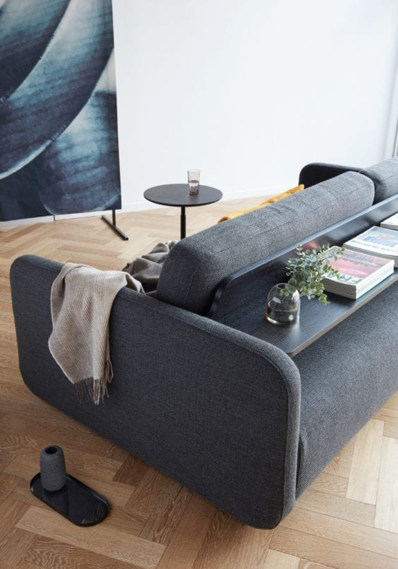grey sofa with back shelf