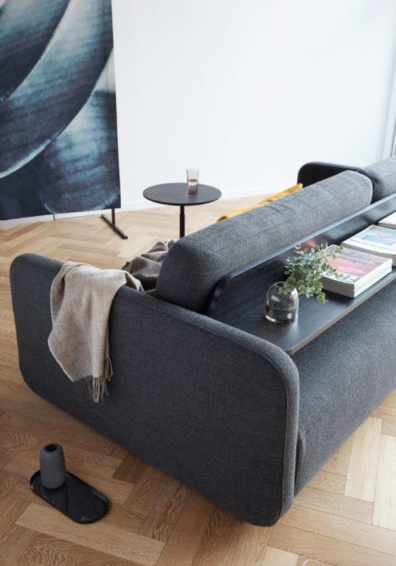 grey sofa with back shelf