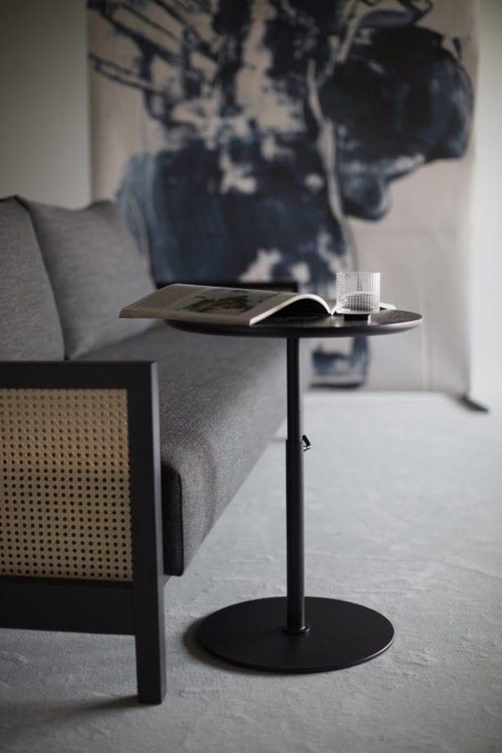 sofa and adjustable coffee table