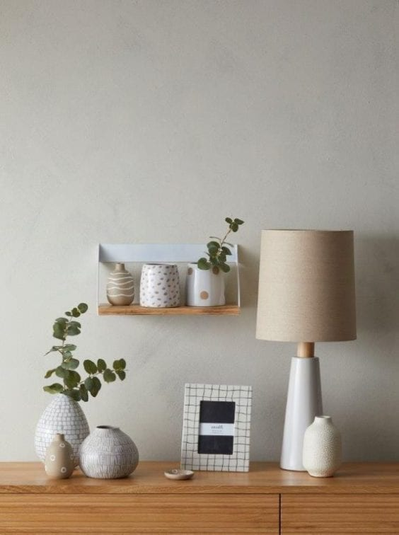 side table with vases and lamp